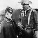 John Wayne (Capt. Nathan Cutting Brittles), Joanne Dru (Olivia Dandridge)