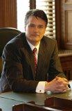 Thomas David McLaughlin (Paul Gross)