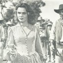 Joanne Dru (Tess Millay), Hank Worden (Simms Reeves)